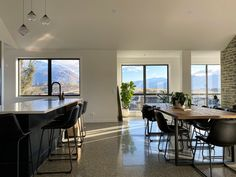 Polished Concrete floors, hand blown glass pendant lihts from Soktas, stone benchtops and full height windows show off views of the world class golf course. Polished Concrete, Showcase Design, Concrete Floors, Hand Blown Glass, Glass Pendants, Luxury Homes, New Homes, Golf, Windows