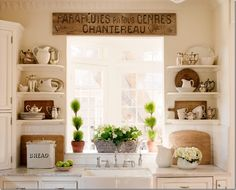 Cottage/French Country kitchen, antique sign, open shelves, bread tin, marble, subway tile, topiary...