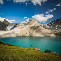 Pristine mountain wilderness, sparkling lakes, stunning landscapes. @meghanjward enjoys a spectacular scene over Coleman Lake, Banff National Park. @paulzizkaphoto on instagram