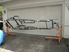 "Chassis Rotisserie by evintho -- Homemade chassis rotisserie constructed from two engine stands and lengths of 1"" square tubing. http://www.homemadetools.net/homemade-chassis-rotisserie-2"