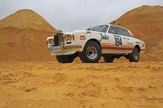 In a lifted Rolls-Royce Corniche was the talk of the Paris-Dakar Rally. Rolls Royce 4x4, Rolls Royce Corniche, Rally, Monster Trucks, Vehicles, Cars, Automobile, Autos, Car