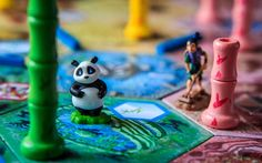 This is Takenoko. It is a family game that has the cutest miniatures I've ever seen on any board game. If you have kids or prefer really light games you should check this out! The whole premise to the game is that you are trying to achieve one of three kinds of objectives. Either you …