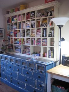I love the blue cabinet and the hutch above.  I want this!