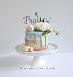 Franco's Baptism Cake - semi naked cake with a blue drip, macarons and fresh flowers
