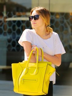 Pop of yellow // Celine - Love the bright purse!