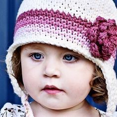 I love these colors! I want to do a knit version of this for Rose! Children's Flowered Earflap Beanie