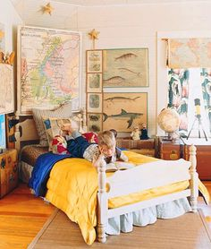 I like the maps and fish.  Great idea to place a map on the curtains. I  like the bed for a Snow White themed girls room though.