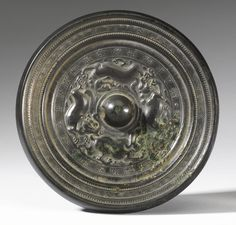 A BRONZE 'MYTHICAL BEASTS' MIRROR, SUI DYNASTY Bronze Mirror, Bronze Age, Antique Items, Antique Mirrors, Fantasy Miniatures, Chinese Ceramics, High Fantasy, Chinese Antiques, Asian Art