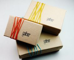 I love the wrap around ribbon on these boxes. It adds color, texture, and an interesting design. Definitely something to keep in mind.