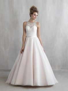 The Maddie a-line bridal gown with illusion neckline. #Aline #IllusionNeckline #Lace #BridalGown #WeddnigGown