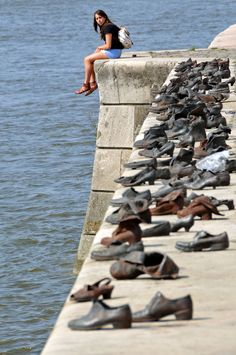 The Shoes on the Danube is a memorial on the bank of the Danube River in Budapest. It honors the Jews who were killed by fascist Arrow Cross. Austria, Budapest Travel, Hungary Travel, La Rive, Holocaust Memorial, Danube River, Photos, Pictures, Places To Travel