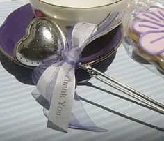 Very cute heart tea strainer wedding favour!