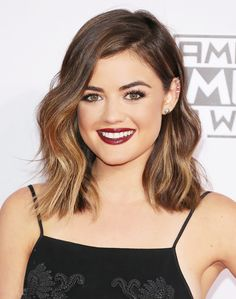 4 Cuts That Make Thin Hair Look Surprisingly Full:  If you're a pro with a curling iron, try adding a wave right in the middle of your hair shaft and leaving the ends straight, like Lucy Hale.