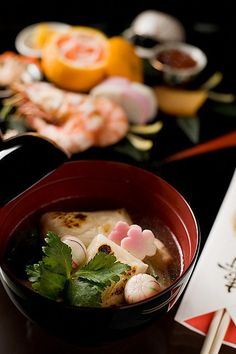 Traditional Japanese meal. Ozouni which is clear soup with mochi rice ...