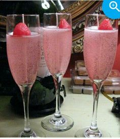Pink gel candle champagne glasses with fake strawberry. Making these for my coffee table display.