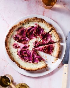 Roasted Radish Tart | Martha Stewart - No, those aren't flowers adorning this creamy cauliflower tart! They're thinly sliced watermelon radishes—they take on that distinctive shape, not to mention that stunning shade of deep fuchsia, when baked. #savorytart #breakfast #brunch