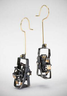 "Laurie Hall: Ferris Wheel, Earrings in darkened sterling silver with gold ear wires. 2 1/4"" long."