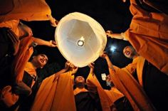 Indonesian Buddhist monks release a lantern after praying at the Borobudur temple during the Vesak festival in Magelang. (AFP Photo/Clara Prima)