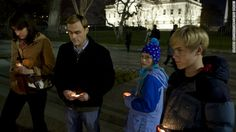 People gather for a vigil outside the White House in Washington following the Connecticut elementary school shooting on Friday.