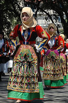 Traditional costume of Sardinia..It looks amazing and impression !!!! Decor with a lot of fussy detail and cordinate colourful..