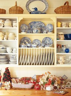 Cream/pale yellow kitchen cabinets with blue & white transferware dishes - NZ House & Garden