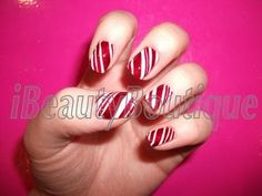 Candy cane nail art - you can also use a toothpick to paint the thin lines if you don't have a thin brush.