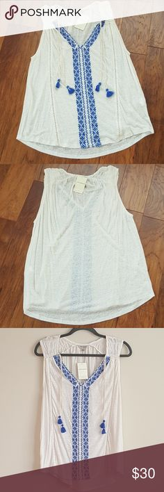 """Lucky Brand Embroidered Top NWT Lucky Brand Embroidered Top Embroidered design Dangling Tassels  Lightweight, slightly see through  Approx. Measurements laying flat Length 25"""" front/27.5"""" back Pit to Pit 21"""" Lucky Brand Tops"""