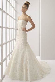 Brides: Two by Rosa Clar�. Reborde lace and bead-work gown, in ivory.