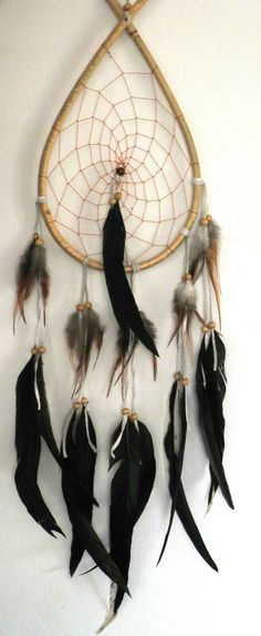 Hand made bamboo tear drop feather dream catcher.Approximately 70-80cm in length.Created with bamboo, feathers and leather.Perfect for any home decor.