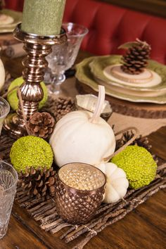 Woodland Wonderland Themed Thanksgiving Tablescape: A twig runner topped with pine cones, white mini pumpkins, and green hedge apples gathered from a walk by the creek become a seasonal and natural centerpiece. Hedge apples are the fruits of the osage orange tree and are also known as horse apples or monkey balls.