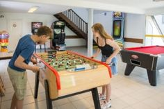 camping la capricieuse - salle de jeux Camping Normandie, Poker Table, Bocce Court, Playground, Swim, Room