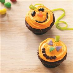 Jack-o'-Lantern Cupcakes Recipe -Carve out a little time to decorate these Halloween pumpkins with Jack-'o-lantern faces. They're a fun treat to make and share!—Taste of Home Test Kitchen