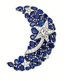 SAPPHIRE AND DIAMOND BROOCH, Chanel, modelled as a crescent moon set with oval sapphires together weighing approximately 11.00 carats, highlighted by a shooting star set with brilliant-cut diamonds together weighing approximately 1.40 carats, mounted in 18 karat white gold, with retractable pendant fitting, signed and numbered 14J210.