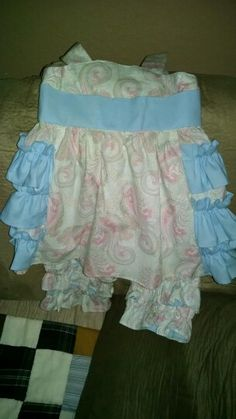 Toddler girls ruffle outfit. Size 2 in blue with pink and light green paisley pattern.