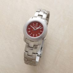 """CHERRY RED SWISS ARMY WATCH--Red-faced but by no means shy, our genuine Swiss Army watch is encased in stainless steel on a brushed stainless bracelet band. Quartz movement, analog calendar, second hand and water resistant to 100 meters. Exclusive. Fits up to 7-1/2"""" wrist. 1-1/4"""" dia. case."""