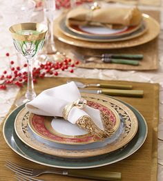 To each table setting set off by simple sprays of red berries