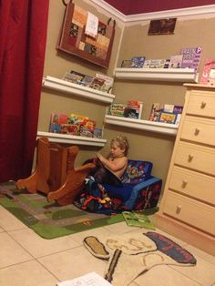 Kids reading corner. Made from plastic rain gutters from Home Depot cut into 3 ft pieces.