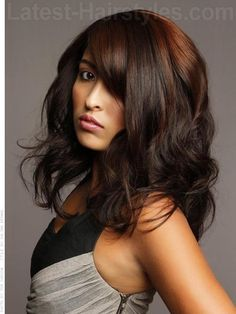 Unexpected tones like copper reds in dark brunette hair look ultra cool when coupled with non-traditional placement.