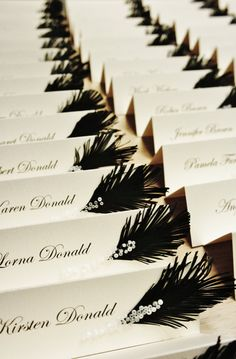 Wedding place cards Black & White feather and glass by liradesigne. I'd love to do this with peacock feathers!