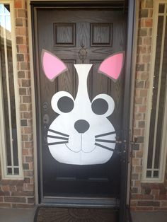 I decorated my front door for my granddaughters 6th birthday party. She wanted a kitty party, so I created a cat.
