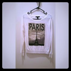 Paris printed long sleeve Cute, loose fitted long sleeve. Ifle tower and paris logo printed in a vintage color. White shirt.  Plain back side. Fitted at the waist and wrist. ORIGINAL PRICE $22.95 Forever 21 Tops