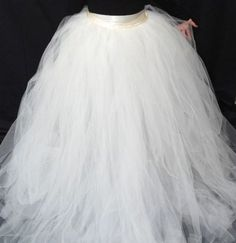 How great is the idea of having a tulle skirt that you can put over a dress and turn it into a wedding dress? It's a lot more affordable than buying a tulle wedding dress, and you get two dresses in...