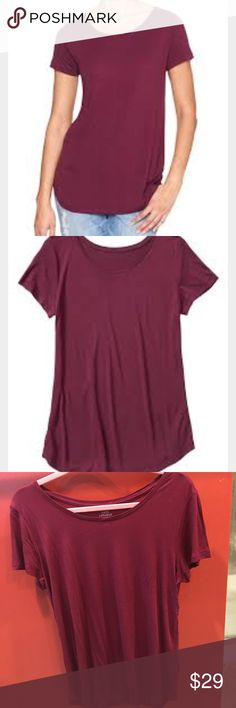 "NWOT Gap Ruby Wine Luxe Short Sleeve T Shirt Brand new and never worn! Super soft and slinky. The most versatile option for dressing up or down with a longer length that covers everything you want it to. Rayon jersey knit. Short sleeves. Scoop neckline. Curved hem is slightly longer in back. 25.5"" shoulder to hem in front and 27"" in back. Chest measures approx 18"" laying flat. Size Large. Color is called Ruby Wine.   100% Rayon. Machine wash Imported. GAP Tops Tees - Short Sleeve"