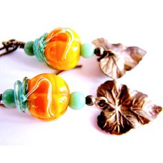 SALE, Orange Pumpkin Earrings, Lampwork Glass Earrings, Leaf Earrings,... ($45) via Polyvore featuring jewelry, earrings, antique brass jewelry, wrap earrings, leaves jewelry, wrap jewelry and pumpkin jewelry
