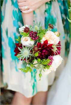 Bridesmaid bouquet with deep red, white, and pops of green. Floral Design ---> Loop Flowers http://www.weddingchicks.com/2014/05/08/fill-your-wedding-with-love-and-adventure/