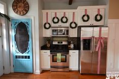 Love the door to the pantry!! Christmas kitchen with bow refrigerator.