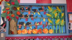 Fall bulletin board. Kids painted leaves, tissue paper pumpkins and corn, construction paper crows