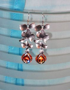 Cascading orchid flowers with a brilliant teardrop of rich golden topaz in Matte rhodium plated silver over brass  Earrings  $ 32.99
