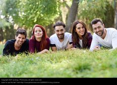 Photo 'Group of young people together outdoors in urban park' by 'javiindy'