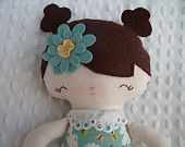 happy little cloth doll made by me using a bit of whimsy pattern